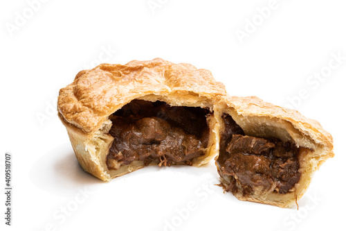 Canvas Print Puff pastry steak pie on baking paper isolated on white
