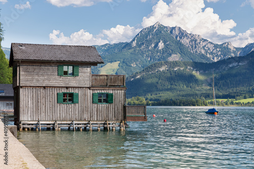 Slika na platnu Wooden boathouse in Sankt Wolfgang am Wolfgangsee surrounded by alps