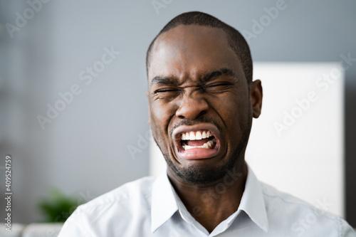 Fotografie, Obraz Sad Frustrated African American Man