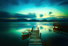 Wooden Pier Or Jetty And A Boat On A Lake Sunset. Versilia Tuscany, Italy