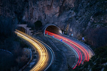 Long Exposure On A Highway That Goes Into Some Tunnels, Leaving The Beams Of Light On The Vehicles On The Road.