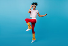 Inspired Black Woman Enjoying Aerobics. Full Length View Of Glamorous African Girl Jumping On Blue Background.