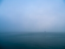 Boat In The Fog In The Bay Of Cadiz Capital, Andalusia. Spain. Europe.