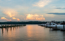 Marina At Sunset With Golden Clouds On Calm Water On The Potomac River, Maryland