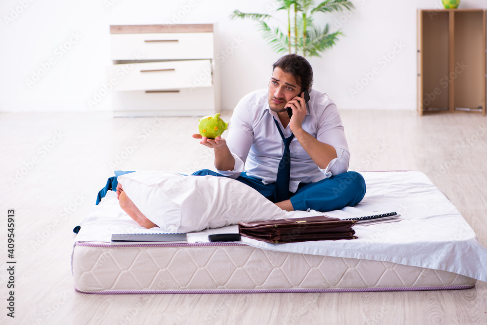 Fototapeta Young male employee working from home during pandemic