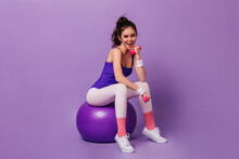 Active Fitness Trainer Woman In Tights In Style Of 80s Demonstrates Exercise For Hands On Fit Ball