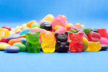 A Pile Of Candy In A Blue Background