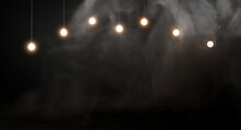 Light Bulbs On Dark Smoke Background.3d Rendering.