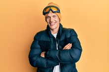 Handsome Caucasian Man Wearing Snow Wear And Sky Glasses Happy Face Smiling With Crossed Arms Looking At The Camera. Positive Person.