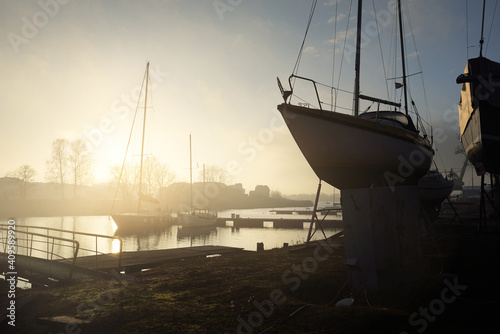 Canvas Print Winterized sloop rigged yacht standing on land, close-up