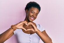Young African American Girl Wearing Casual Clothes Smiling In Love Doing Heart Symbol Shape With Hands. Romantic Concept.