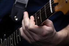 Musician's Hand On Guitar Neck