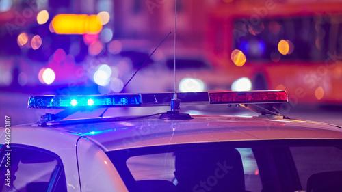 Billede på lærred Police car lights at night city street