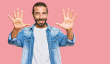 Attractive Man With Long Hair And Beard Wearing Casual Denim Jacket Showing And Pointing Up With Fingers Number Ten While Smiling Confident And Happy.