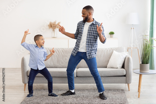 Obraz Happy African Father And Son Dancing At Home, Full Length - fototapety do salonu