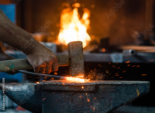 Close up blacksmith working metal with hammer on the anvil in the forge Tapéta, Fotótapéta
