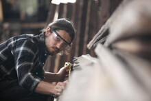 Carpenter, Joiner Is Working In The Workshop. Man At Work On Wood.Image Of Mature Carpenter In The Workshop,furniture Making Concept.