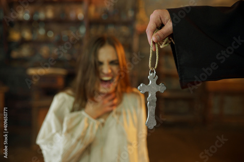 Canvas Print Exorcist casting out devil from scary woman