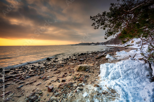 Obraz Snowy beach in Gdynia Orlowo at sunrise, Baltic Sea. Poland - fototapety do salonu