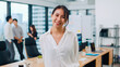Leinwandbild Motiv Portrait of successful beautiful executive businesswoman smart casual wear looking at camera and smiling in modern office workplace. Young Asia lady standing in contemporary meeting room.