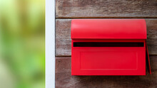 Red Mailbox On Wood Background For Posting Letters.