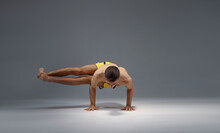 Muscular Yoga Stands On Hands In Difficult Pose