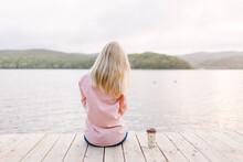 Girl Sitting Near The Sea