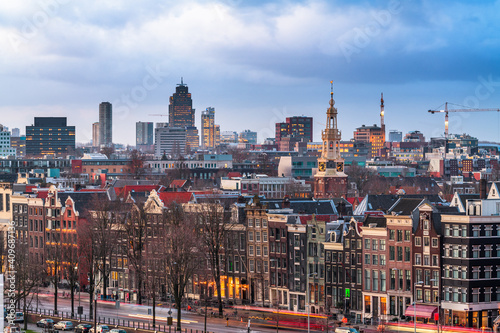 Fototapeta Amsterdam, Netherlands historic cityscape with the modern Zuidas district in the distance obraz