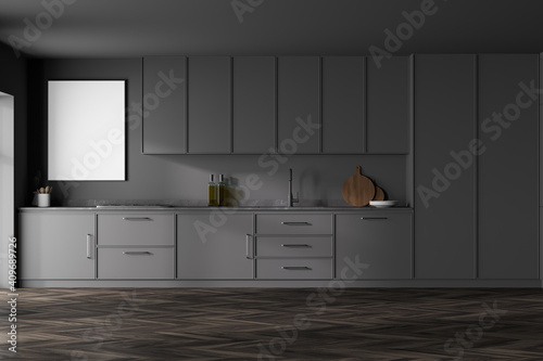 Fotografia Modern kitchen interior with gray walls, modern countertops with a built in sink and a cooker
