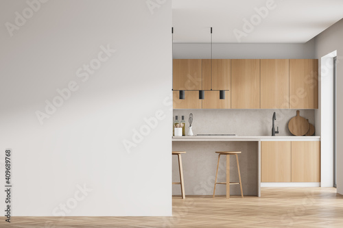 Leinwand Poster Modern kitchen interior with white wall, wooden countertops with a built in sink and a cooker