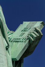 Detail Of The Tabula Ansata Held By The Hand Of The Statue Of Liberty With The Date Of The US Declaration Of Independence July 4th, 1776