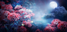 Fantasy Magical Enchanted Fairy Tale Landscape With Forest Lake, Fabulous Fairytale Blooming Pink Rose Flower Garden And Two Butterflies On Mysterious Blue Background And Glowing Moon Ray In Night