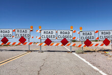Highway Road Closed Signs And Barricades Near Route 66 In The California Mojave Desert.
