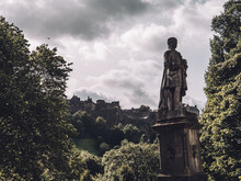 Statue In Edinburgh With The Edinburgh Castle In The Back