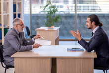Two Businessmen Discussing Business Project