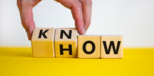 Know How Symbol. Businessman Turns Cubes And Changes The Word 'how' To 'know'. Beautiful Yellow Table, White Background. Copy Space. Business And Know How Concept.