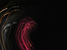 Abstract Neon Lights Of Fireworks On The Sky.