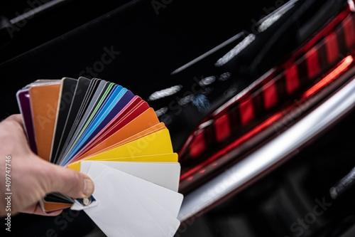Man choosing color of his car with color sampler. Car foil wrapping colors picker © Daniel Jędzura