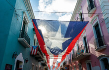 Large Puerto Rican Flag Hanging In The Streets Of Old San Juan, Puerto Rico