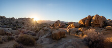 Last Light Of Sunset Behind Rocks And Boulders In Panoramic View Of Desert Landscape On A Sunny January Day With Clear Blue Sky In Yucca Valley, California Near Joshua Tree National Park