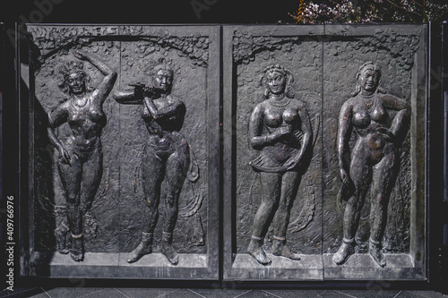 Obraz Doors with reliefs of naked voluptuous women in the entrance of buddhist temple in Osaka, japan - fototapety do salonu