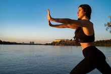 Young Woman By The River Doing Tai Chi Poses, Energy  Balance