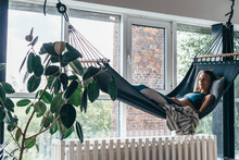 Woman Is Lying At Home In A Hammock And Resting