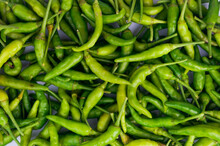 Green Thai Chile Peppers Vary In Size And Shape, Depending On The Specific Variety, And Are Generally Small, Conical, And Slender, Tapering To A Point On The Non-stem End.