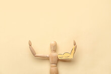 Wooden Mannequin With Drawn Muscular Arm On Color Background