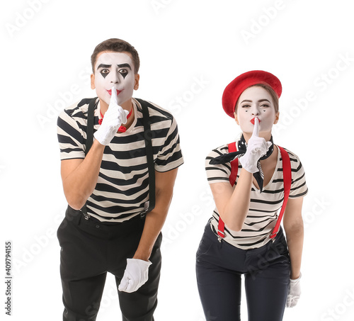 Fotografie, Obraz Male and female pantomimists showing silence gesture on white background