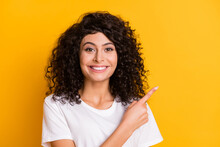 Portrait Of Young Lovely Pretty Smiling Cheerful Positive Girl Pointing Finger Copyspace Isolated On Yellow Color Background