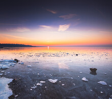 Frozen Lake Balaton With Colorful Sunset