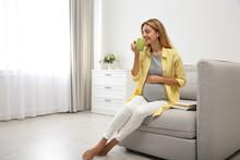 Beautiful Pregnant Woman Drinking Tea At Home