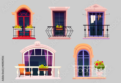 Fotografie, Obraz Vintage balconies with glass doors, windows, flowers in pots and fences